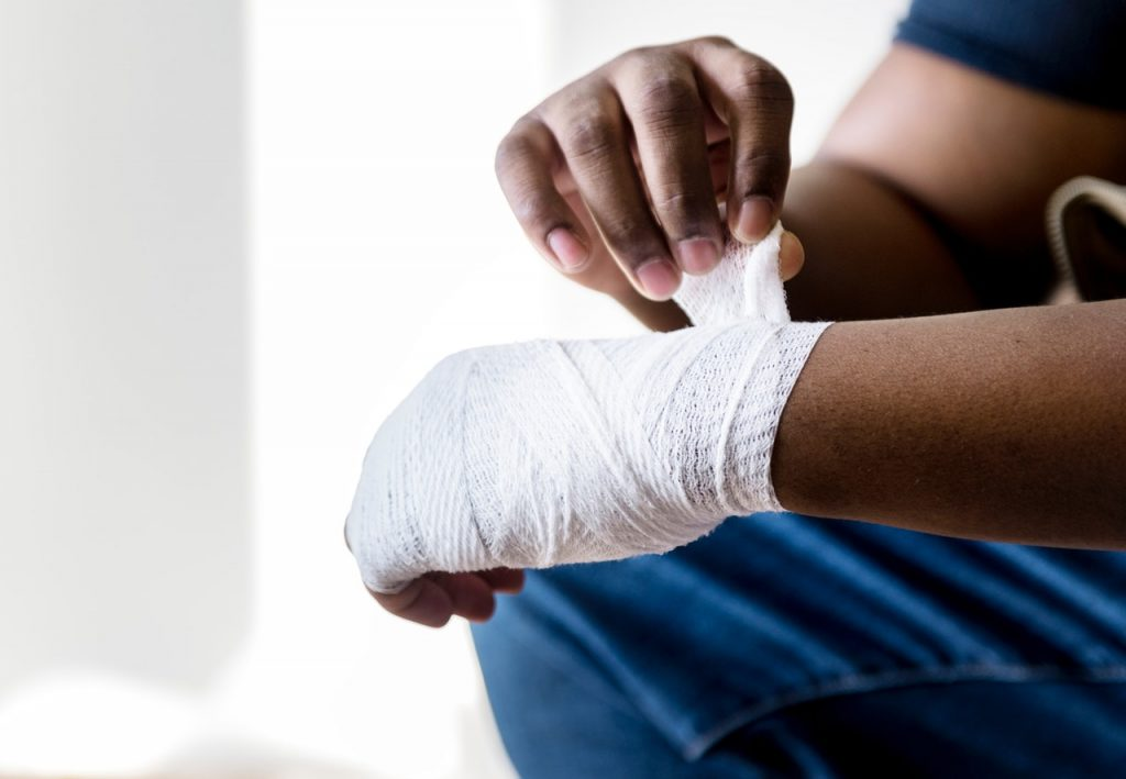 Person with bandage on hands